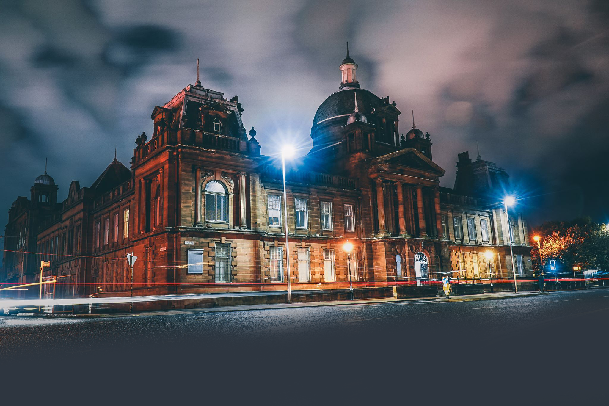 A night shot of Film City Glasgow's building.