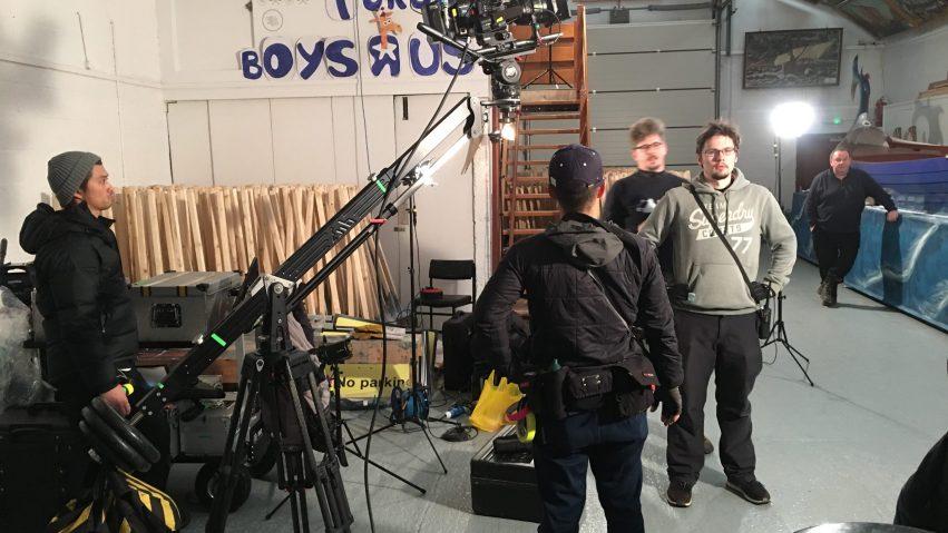 Crew stand around a camera jib on set in Shetland.