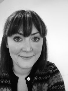 A black and white portrait of Louise our Company Producer.